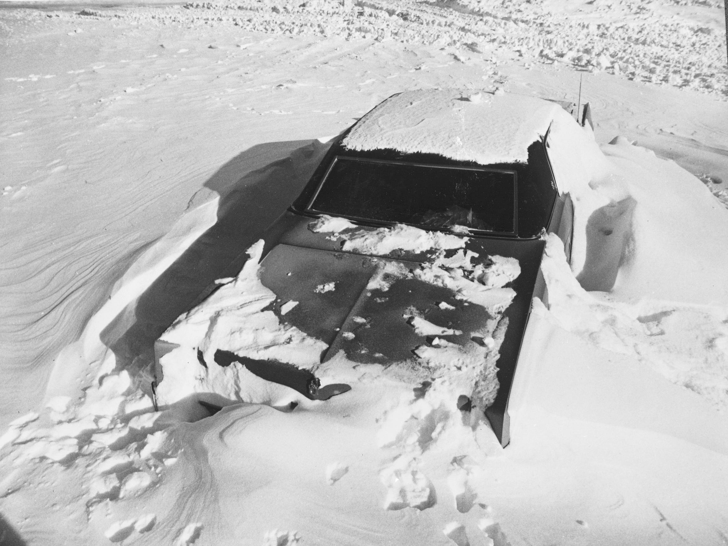 A car lies buried in a snowdrift at the South Shore Yacht Club after the second of three snowstorms socked Milwaukee in January 1979. This photo was published in the Jan. 16, 1979, Milwaukee Journal.
