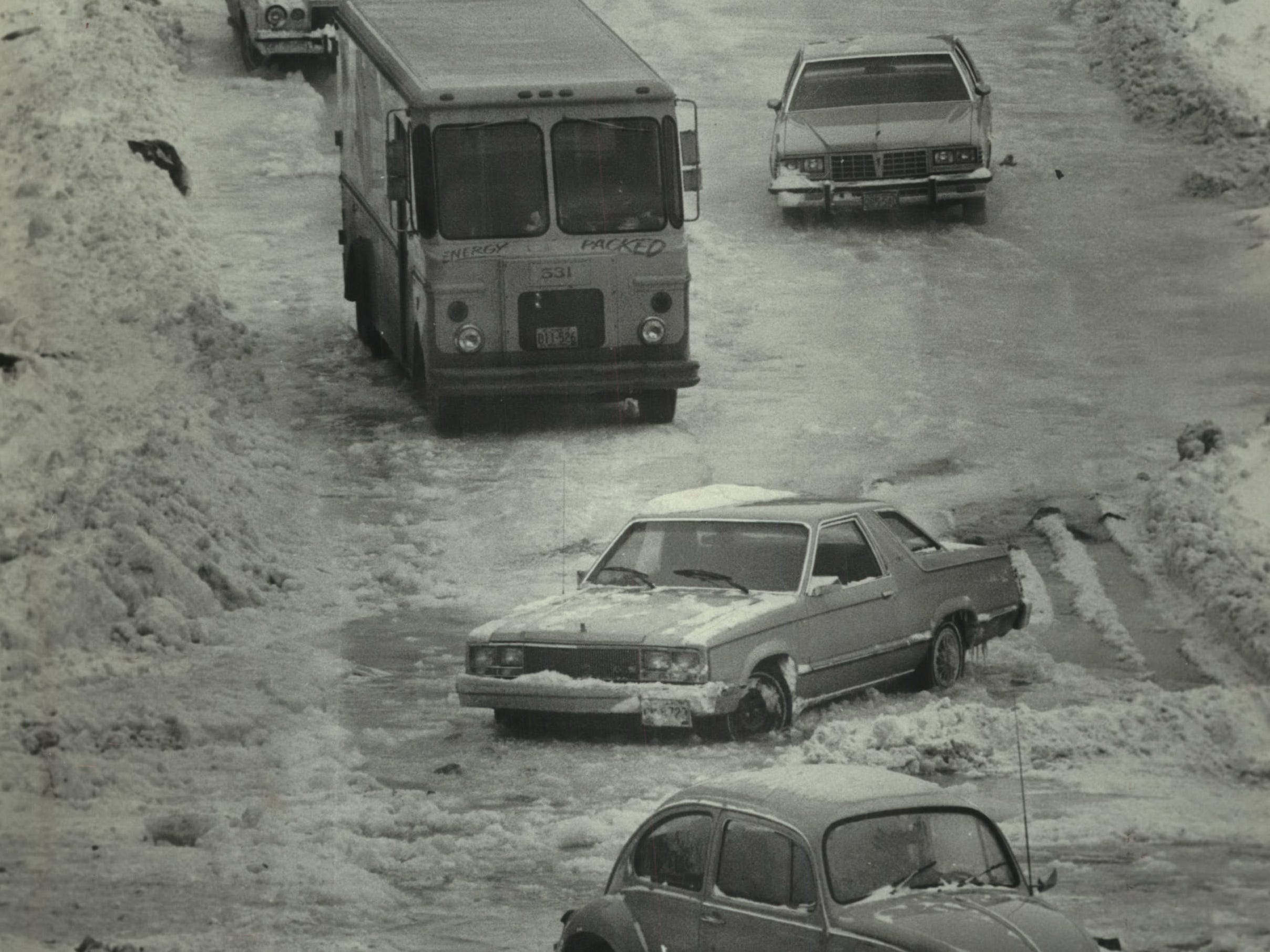 A ruptured water line added misery, and ice, to a still barely plowed Highland Boulevard near Milwaukee Area Technical College on Jan. 15, 1979. The water, on top of the still-slushy streets, left some vehicles stuck and, later, frozen in place on the street. This photo was published in the Jan. 15, 1979, Milwaukee Journal.
