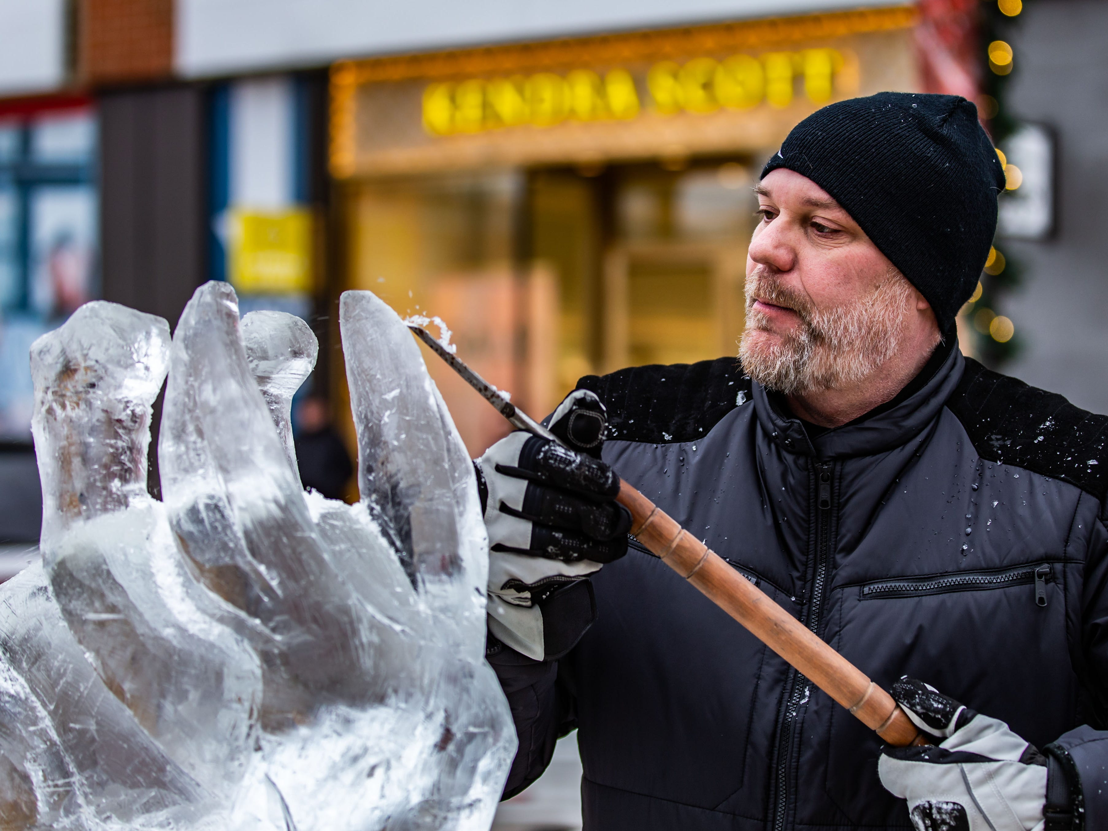 Neal Vogt of Waukesha competes in the Wisconsin State Ice Carving Championships held during Winter Fest at The Corners of Brookfield on Saturday, Jan. 12, 2019.