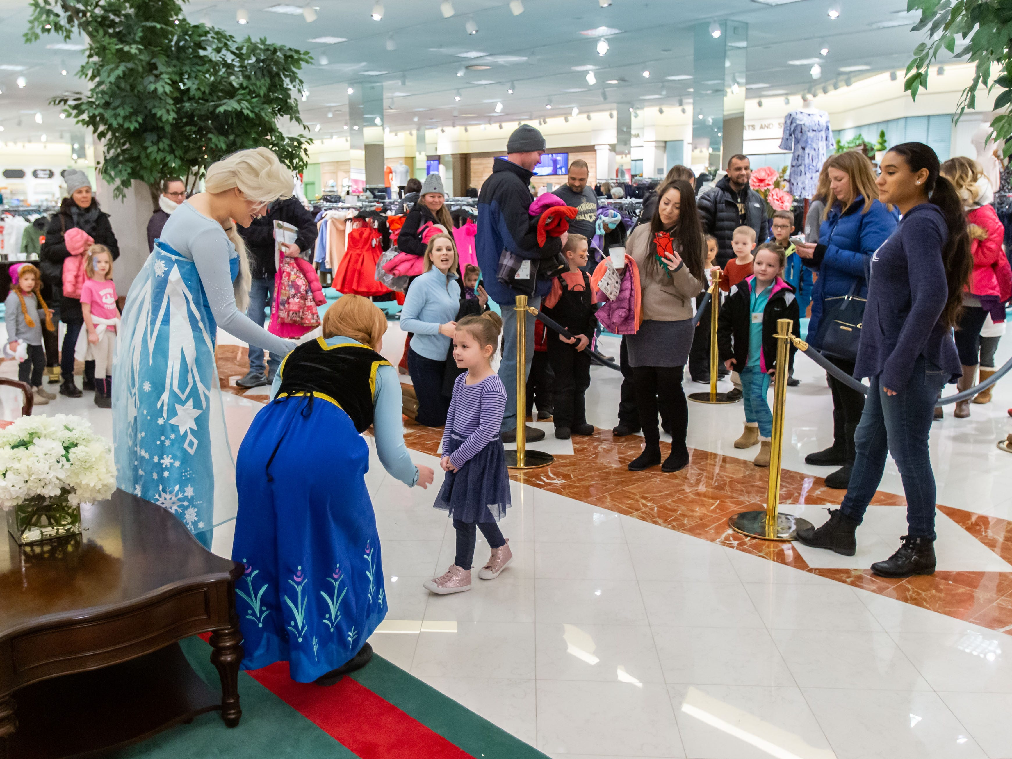 """Families gather to meet the """"Frozen"""" princesses, Elsa and Anna, inside the Von Maur department store during Winter Fest at The Corners of Brookfield on Saturday, Jan. 12, 2019. The event included the Wisconsin State Ice Carving Championships, a screening of the movie """"Frozen"""", face painting, a caricature artist and much more."""