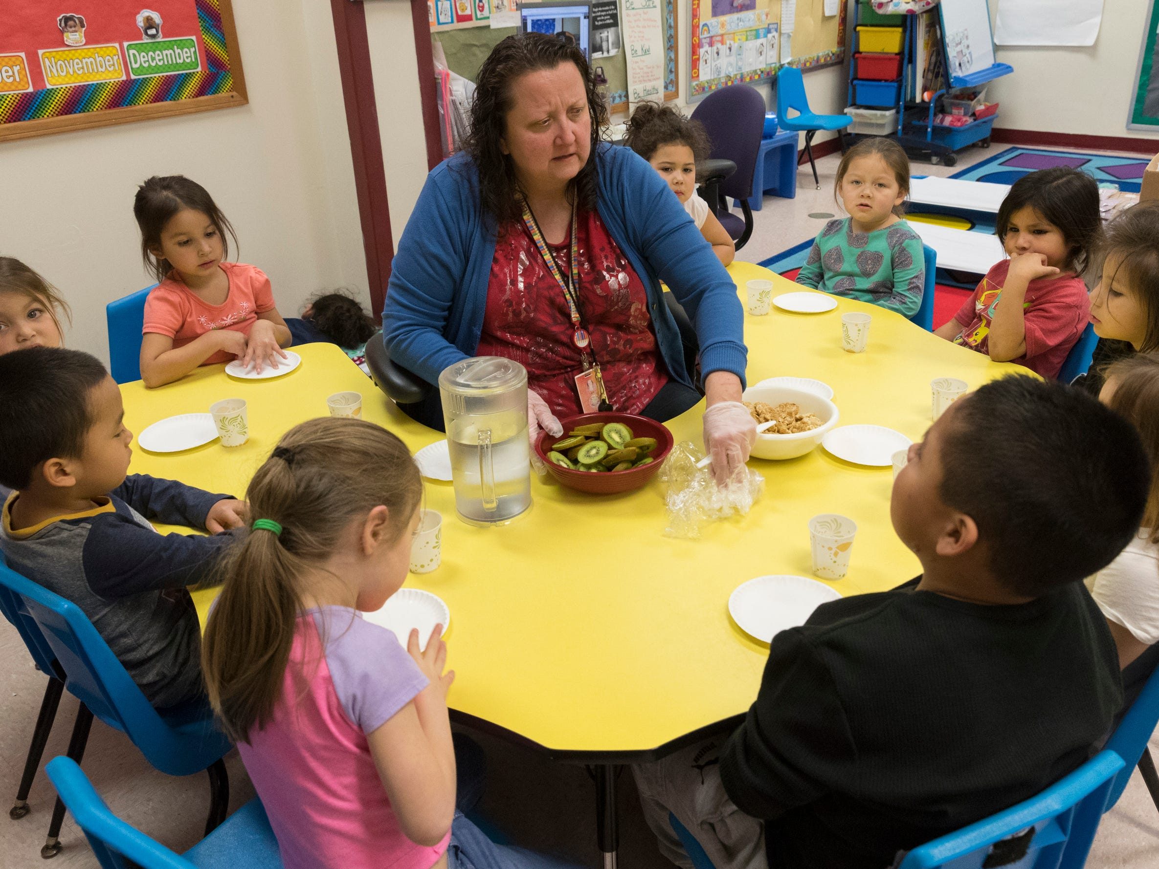 Head Start teacher Lisa Hyde serves snacks to her students Wednesday, Jan.  9, 2019, on the Oneida Indian Reservation in Oneida. The tribe is faring better with the shutdown of the federal government than other tribes because of planning done in the wake of the 2013 shutdown. Head Start is a federally funded program.