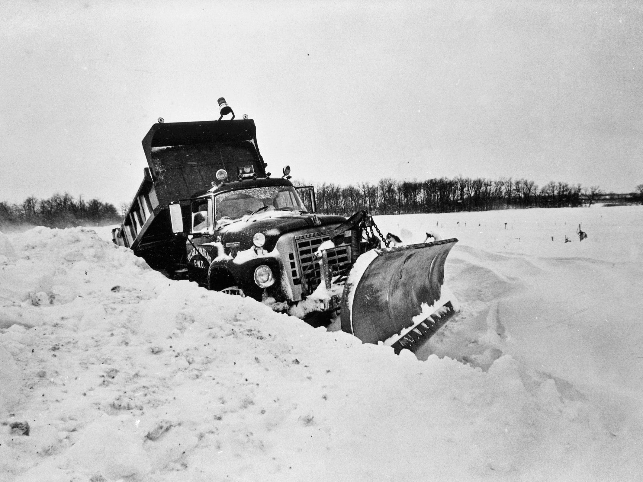 A Village of Hartland snowplow gets stuck trying to plow out Highway 83 north of Highway 16 on Jan. 24, 1979, during the third blizzard that hit the Milwaukee area that month. This photo was published in the Jan. 25, 1979, Milwaukee Journal.