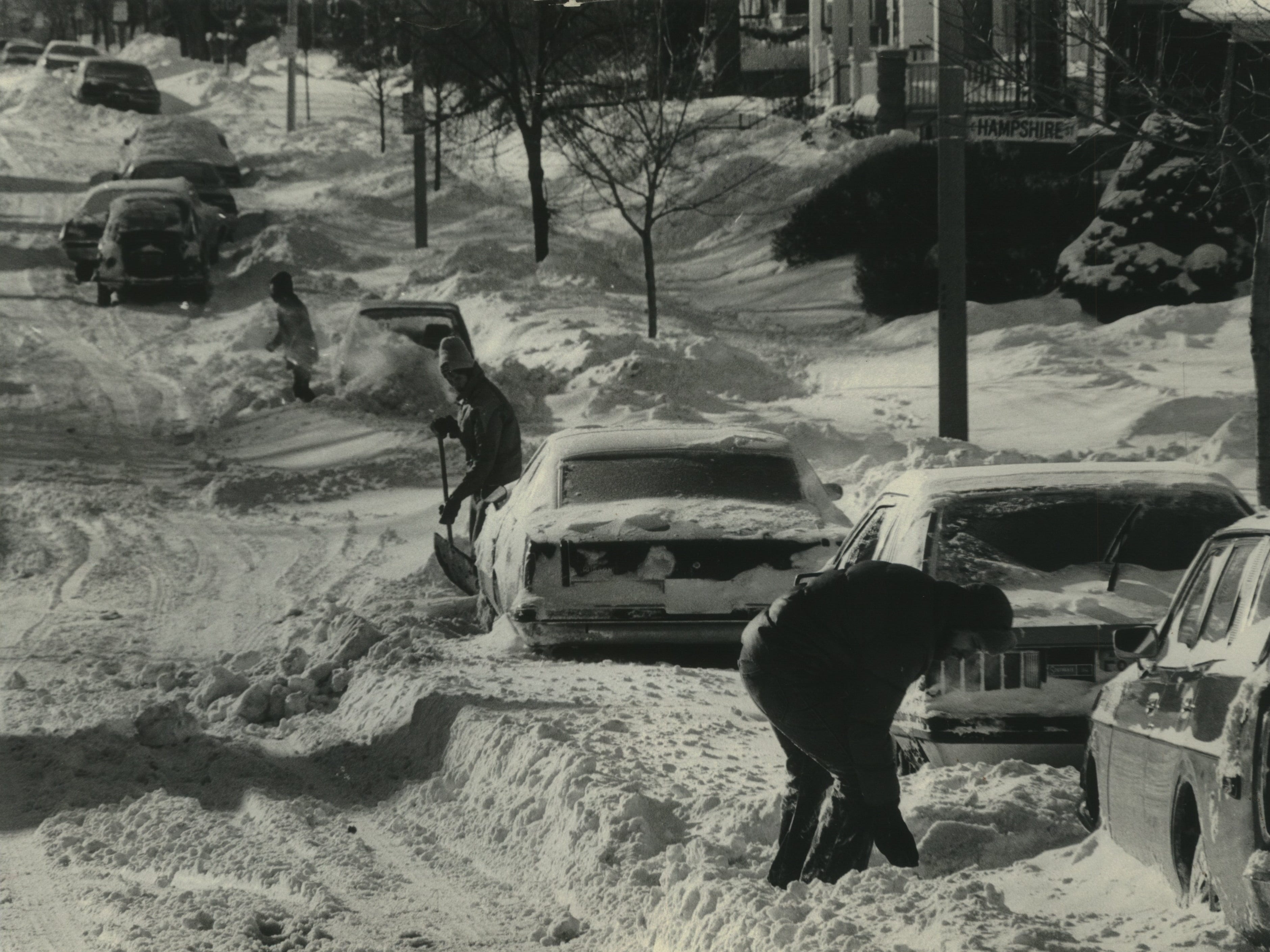 Car owners begin digging out along the 3200 block of N. Newhall St. on Milwaukee's east side on Jan. 14, 1979. City snowplows, trying to make the streets passable, plowed in cars all over the east side. This photo was published on Jan. 15, 1979, in both The Milwaukee Journal and Milwaukee Sentinel.
