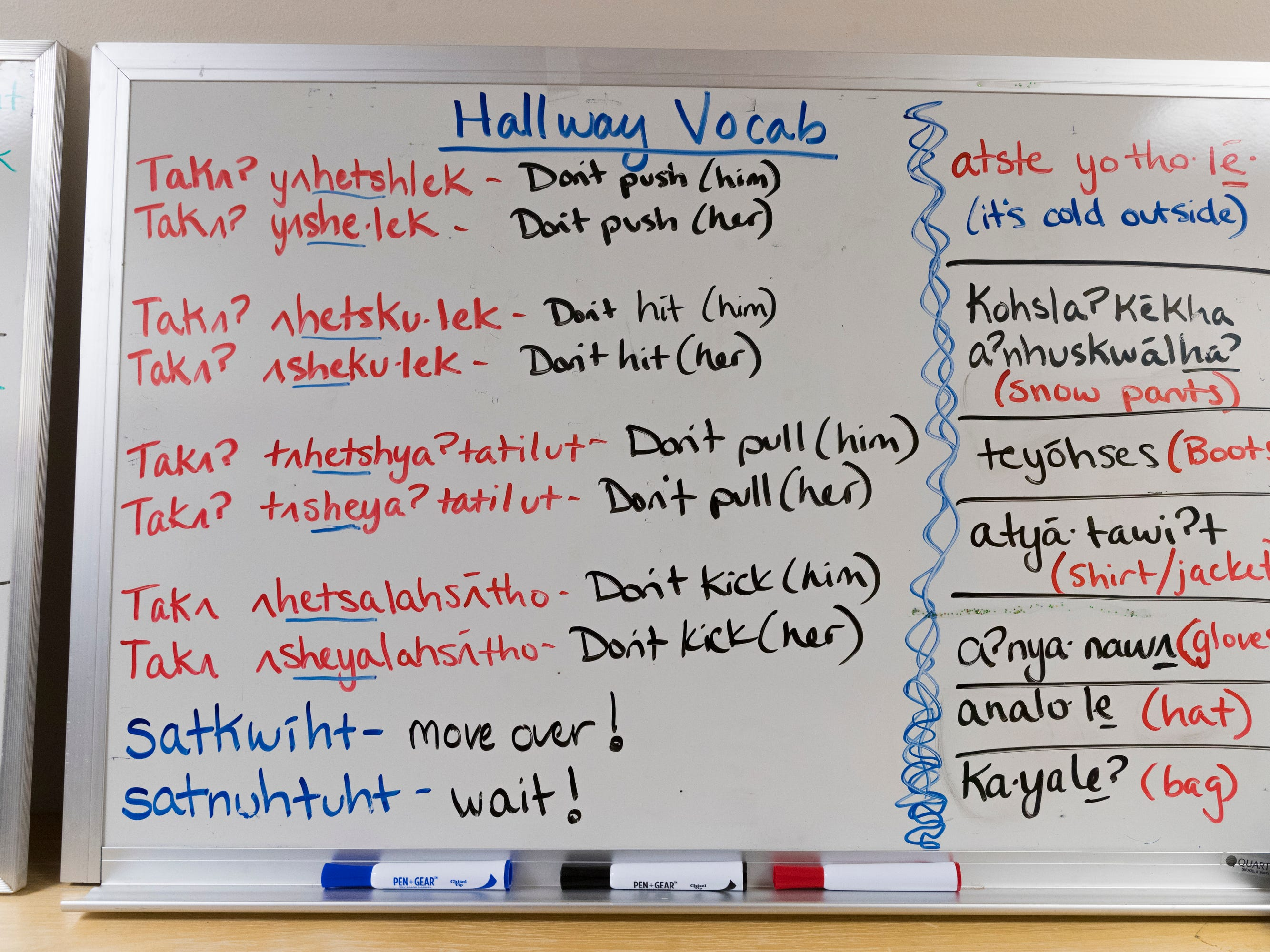 A dry erase board shows English words and their equivalent in the Oneida language outside a Head Start classroom on the Oneida Indian Reservation in Oneida.