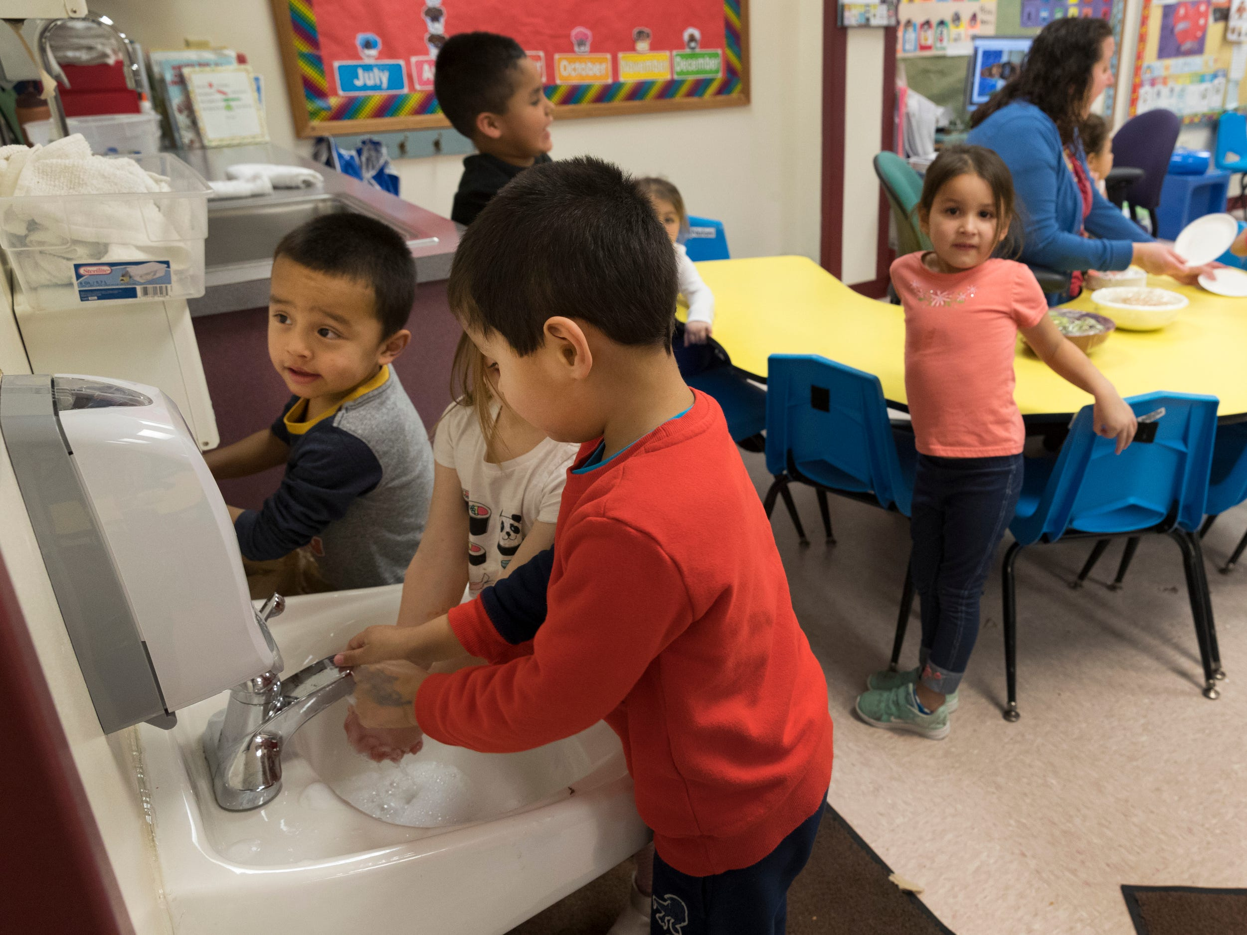 Students wash their hands while Head Start teacher Lisa Hyde serves snacks on the Oneida Indian Reservation in Oneida. The tribe is faring better with the shutdown of the federal government than other tribes because of planning done in the wake of the 2013 shutdown. Head Start is a federally funded program.