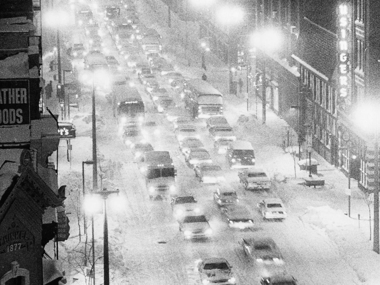Cars struggle south on what was then North Third Street near State Street in downtown Milwaukee, through a blizzard during rush hour on Jan. 15, 1979. This photo was published in the Jan. 16, 1979, Milwaukee Sentinel.