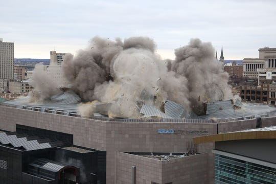 The Milwaukee Bucks blow the massive steel roof off the Bradley Center in Milwaukee on Sunday. The roof blast was one of the most remarkable steps related to the closing of the Bradley Center, the Bucks' home for 30 years, and opening of their new $524 million Fiserv Forum.