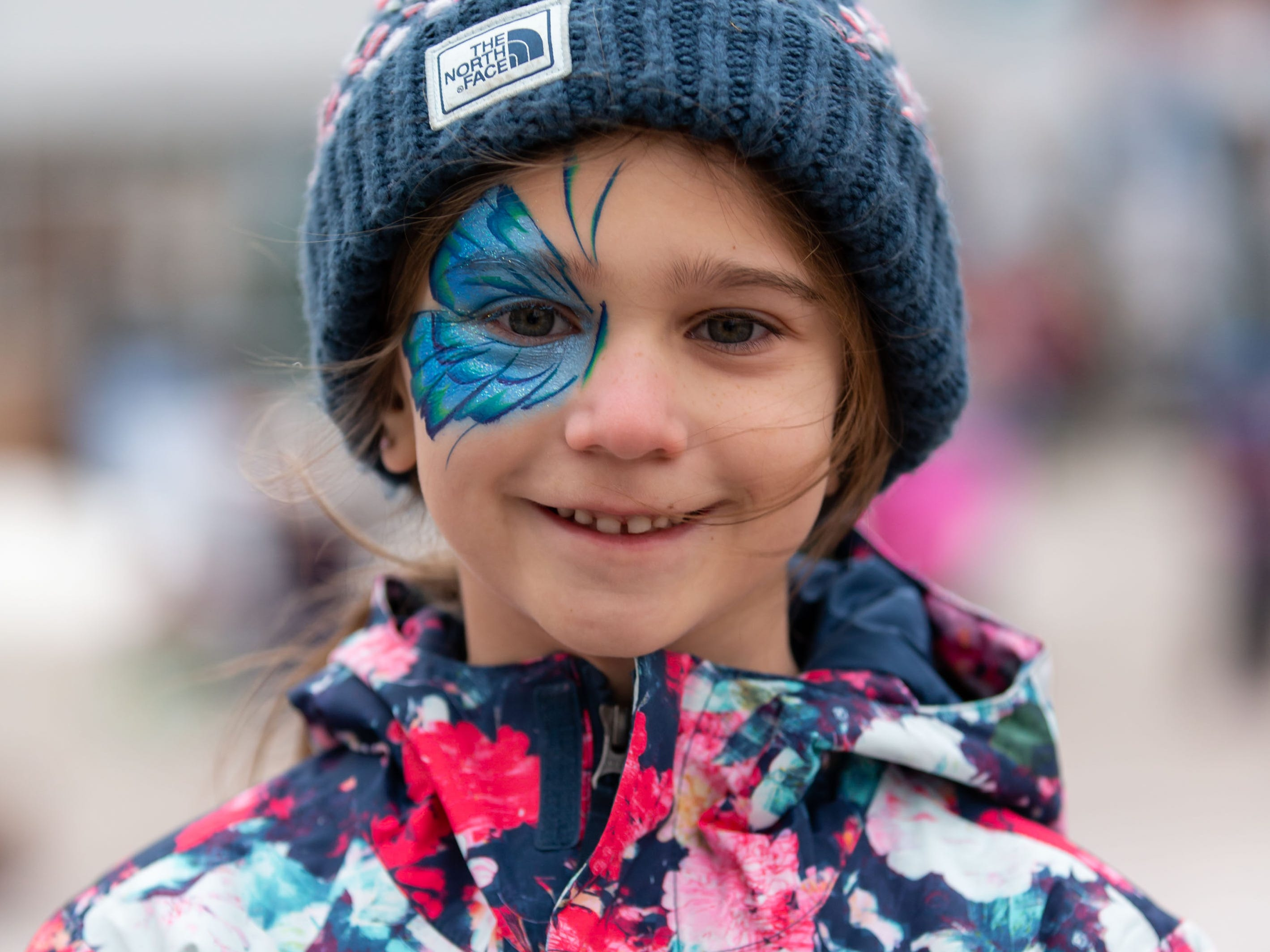 """Arden Wiedmeyer, 7, of Menomonee Falls sat for a face painting during Winter Fest at The Corners of Brookfield on Saturday, Jan. 12, 2019. The event included the Wisconsin State Ice Carving Championships, a screening of the movie """"Frozen"""", face painting, a caricature artist and much more."""