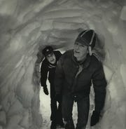 Paul Raddatz and John Maglio, finishers at C.S. Raddatz Leather Co. in Ixonia, enter the company's plant through a tunnel dug through an 11-foot drift that blocked the doorway on Jan. 15, 1979. This photo was published in the Jan. 16, 1979, Milwaukee Journal.