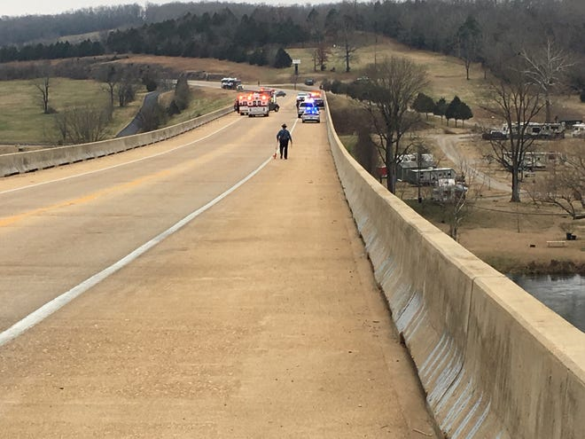 An Arkansas State Police Trooper works the scene of a multi-vehicle accident Sunday afternoon on the U.S. 62/412 bridge over the White River in Cotter.