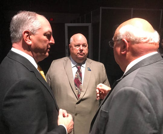 Gov. John Bel Edwards, Agriculture Commissioner Mike Strain and Louisiana Farm Bureau President Ronnie Anderson talk after the governor addressed the American Farm Bureau convention in New Orleans.