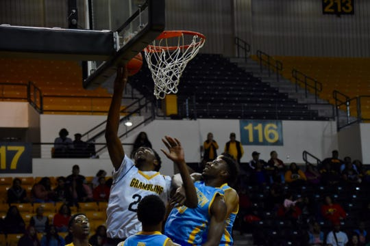 Grambling State junior center Travon Bunch (24) lays the ball up against Southern during Saturday's SWAC game at the Fredrick Hobdy Assembly Center.