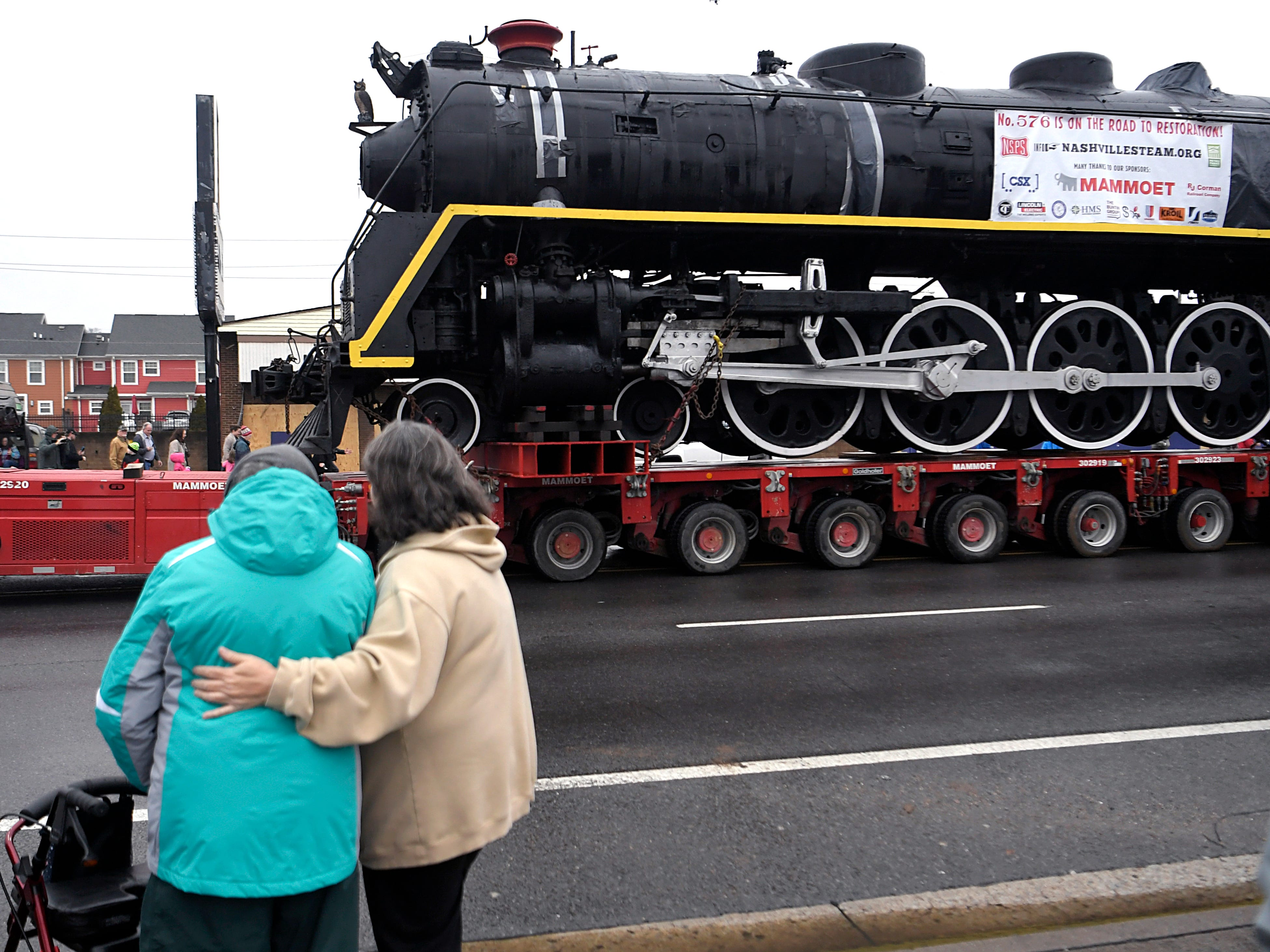 People watch as locomotive No. 576 is being transported down Charlotte Ave. on Sunday, Jan.  13, 2019.  The locomotive has been on display in Centennial Park for 65 years.