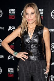 """Sheryl Crow walks the red carpet before the """"Willie: Life & Songs of an American Outlaw"""" concert at Bridgestone Arena in Nashville on Jan. 12, 2019."""