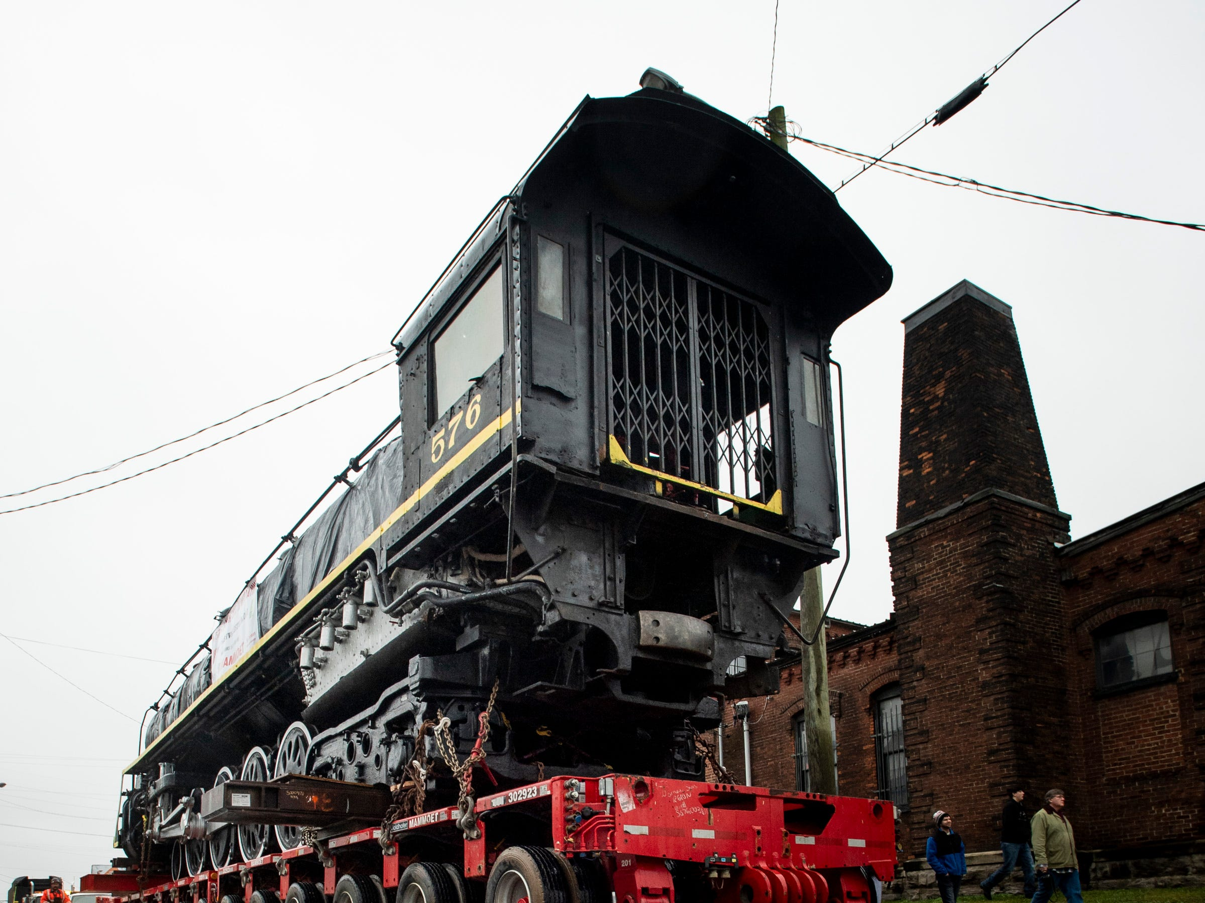 Former Nashville, Chattanooga & St. Louis Railway steam locomotive No. 576 is moved down 12th Ave. North in Nashville, Tenn., Sunday, Jan. 13, 2019. The train, which will be restored to working condition over approximately four years, has been on display in Centennial Park since 1953.
