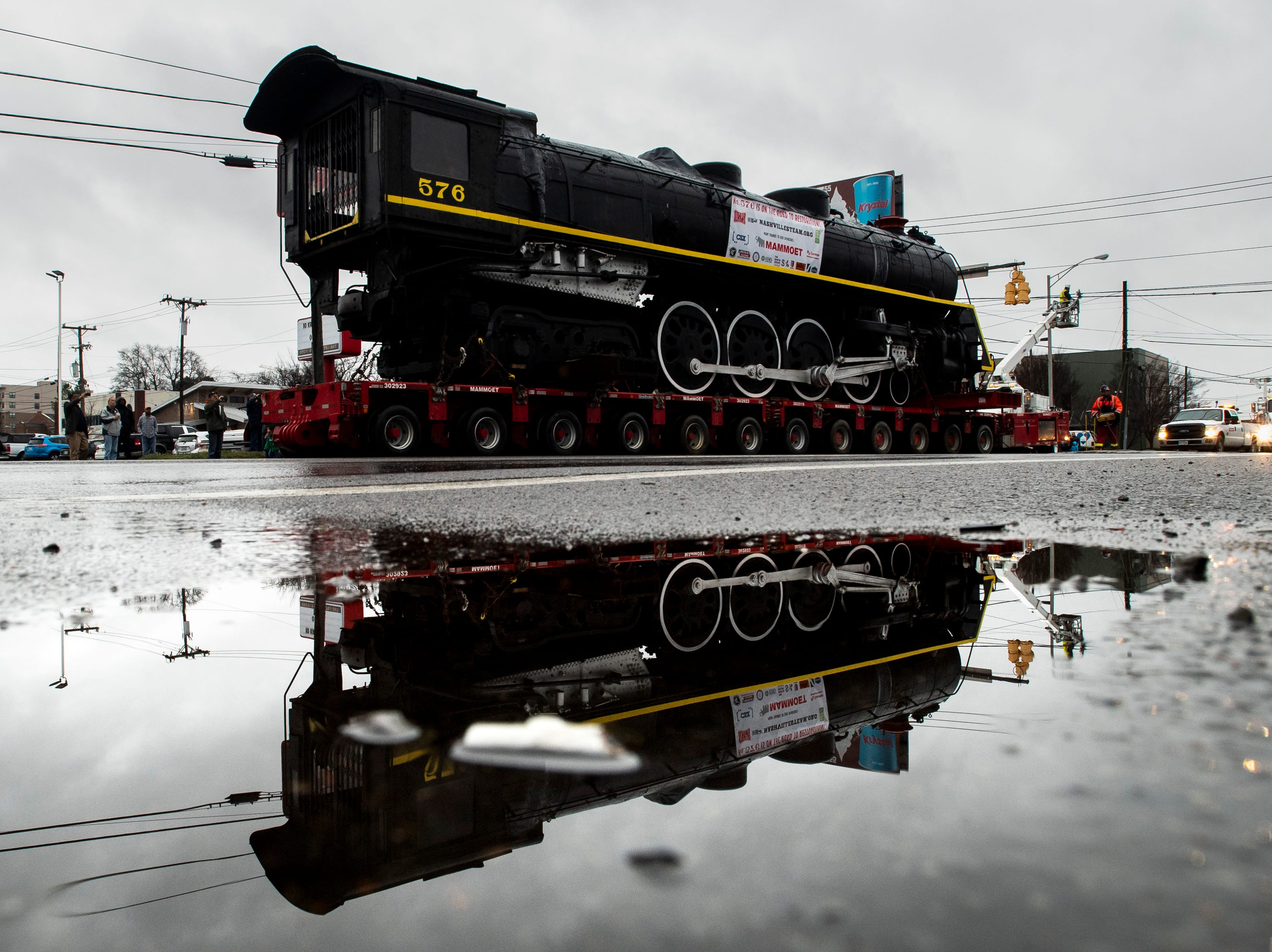 Former Nashville, Chattanooga & St. Louis Railway steam locomotive No. 576 is moved down Charlotte Ave. in Nashville, Tenn., Sunday, Jan. 13, 2019. The train, which will be restored to working condition over approximately four years, has been on display in Centennial Park since 1953.