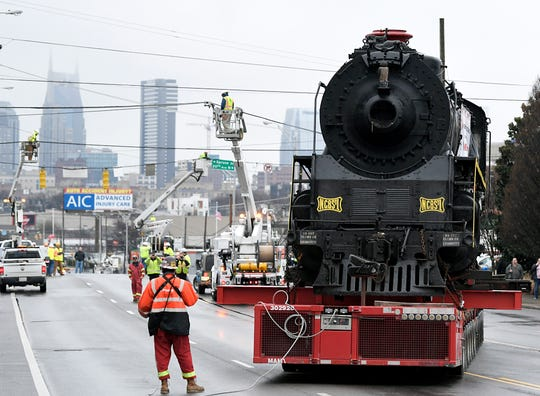 Mammoet transport workers move locomotive No. 576 down Charlotte Ave. in Nashville on Sunday, Jan.  13, 2019 as part of the renovation project.  The locomotive has been on display in Centennial Park 65 years.