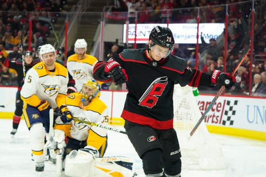 Hurricanes center Sebastian Aho (20) celebrates his second-period goal Sunday.
