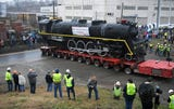The 300-ton locomotive was pulled out of its shed at Centennial Park, where it has been on display for 65 years. It's now set to be restored and revived to carry passengers once again.