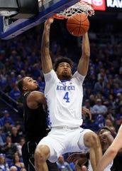 Kentucky's Nick Richards (4) dunks near Vanderbilt's Joe Toye on Jan. 12, 2019.