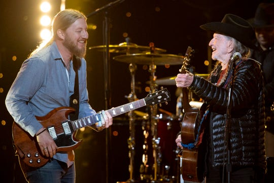 Derek Trucks and Willie Nelson perform during the Willie: Life & Songs of an American Outlaw concert at Bridgestone Arena in Nashville, Tenn., Saturday, Jan. 12, 2019.