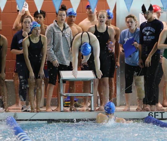 Kelly Reynolds of Wayne Valley dives in following team mate Samantha Maybrown inn the 200 Yard Freestyle Relay. They came in second place.