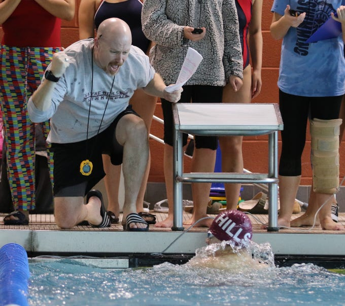 The Wayne Hills girls win coach Mike Shale is fired up over Marc Sim winning the boys 100 Yard Breaststroke.