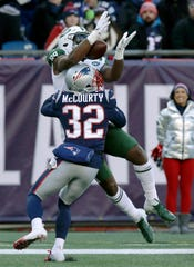 New England Patriots defensive back Devin McCourty (32) breaks up a pass intended for New York Jets tight end Chris Herndon during the first half of an NFL football game, Sunday, Dec. 30, 2018, in Foxborough, Mass.