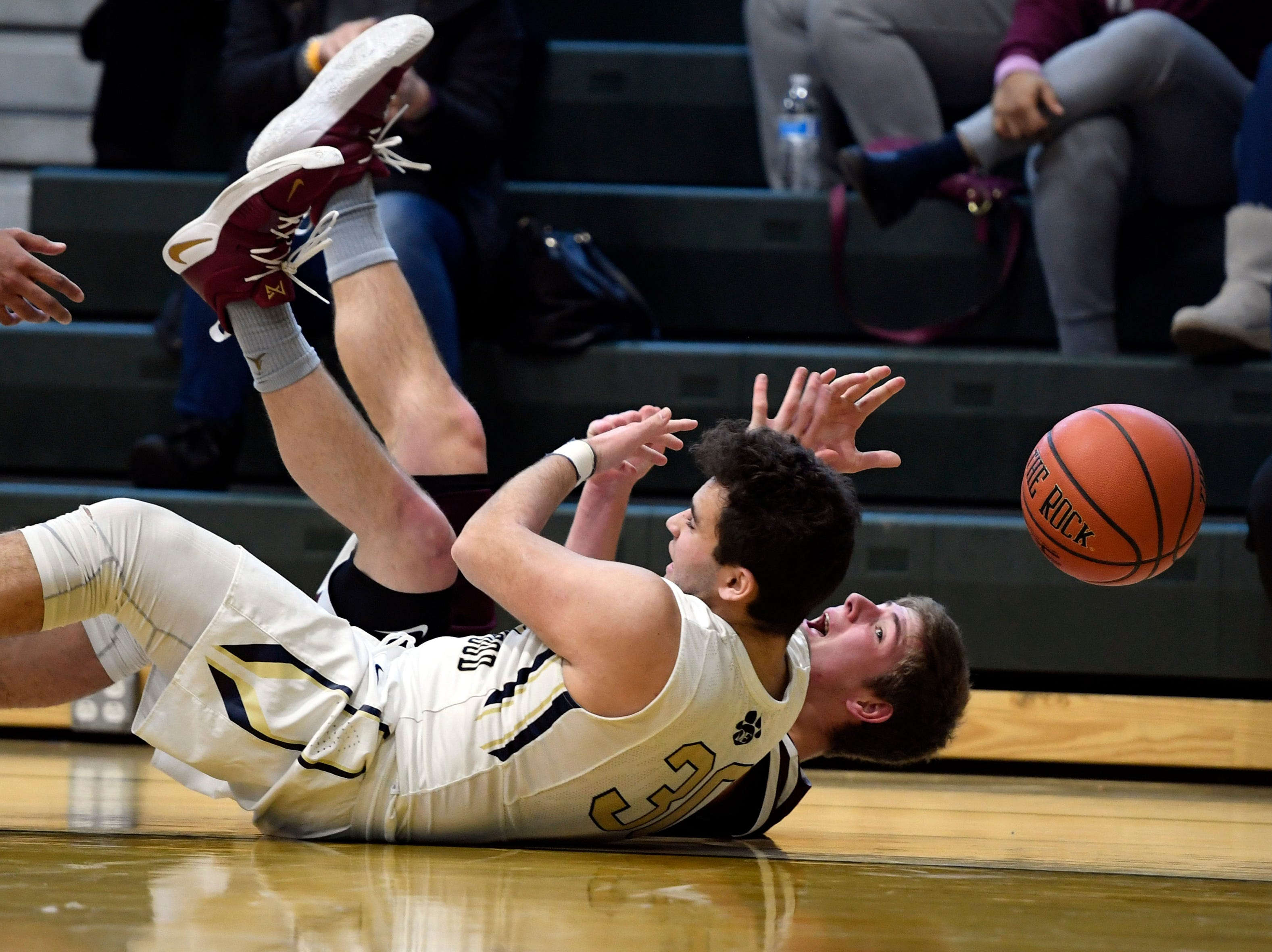 Dwight Englewood's Harrison Ruff (front) and Wayne Hills' Jake Belli fall as they fight for possession. Wayne Hills defeated Dwight Englewood 51-36 in Day 2 of the Public vs. Private Basketball Showcase at St. Joseph Regional on Sunday, Jan. 12, 2019, in Montvale.