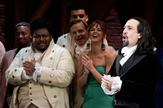 Lin-Manuel Miranda, right, composer and creator of the award-winning Broadway musical, Hamilton, offers a  message of gratitude after receiving a standing ovation at the end of the play's premiere held at the Santurce Fine Arts Center, in San Juan, Puerto Rico, Friday, Jan. 11, 2019.
