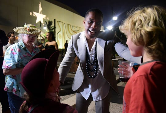 Leslie Odom Jr., the actor that plays the role of Aaron Burr greets people at the entrance plaza of the Santurce Fine Arts Center moments before the premiere of the award-winning Broadway musical, Hamilton, starring its creator, New York native of Puerto Rican descent Lin-Manuel Miranda, in San Juan, Puerto Rico, Friday Jan. 11, 2019. The musical is set to run for two weeks and will raise money for local arts programs.