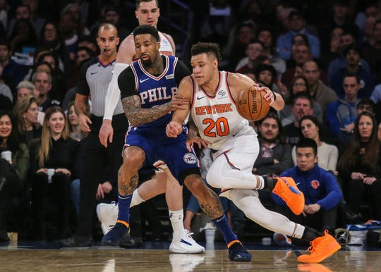 New York Knicks forward Kevin Knox (20) drives to the basket against the Philadelphia 76ers in the first quarter at Madison Square Garden.