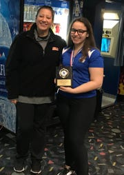Teaneck junior Mia Aish accepts the high-series trophy from Bergen County Women's Coaches Association co-president Nicole Pacciani after shooting a first-place 672 at the Bergen girls bowling tournament on Jan. 12, 2019.