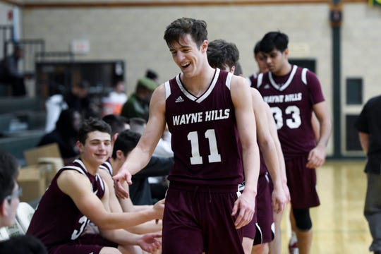 Wayne Hills' Brett Wood celebrates at the bench after defeating Dwight Englewood 51-36 in Day 2 of the Public vs. Private Basketball Showcase at St. Joseph Regional on Sunday, Jan. 12, 2019, in Montvale.
