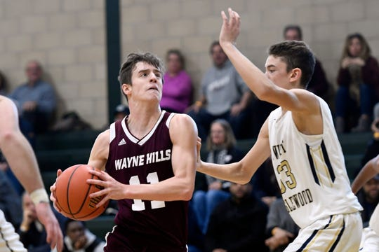 Brett Wood and Wayne Hills seek to defend their title at the Passaic County boys basketball tournament.