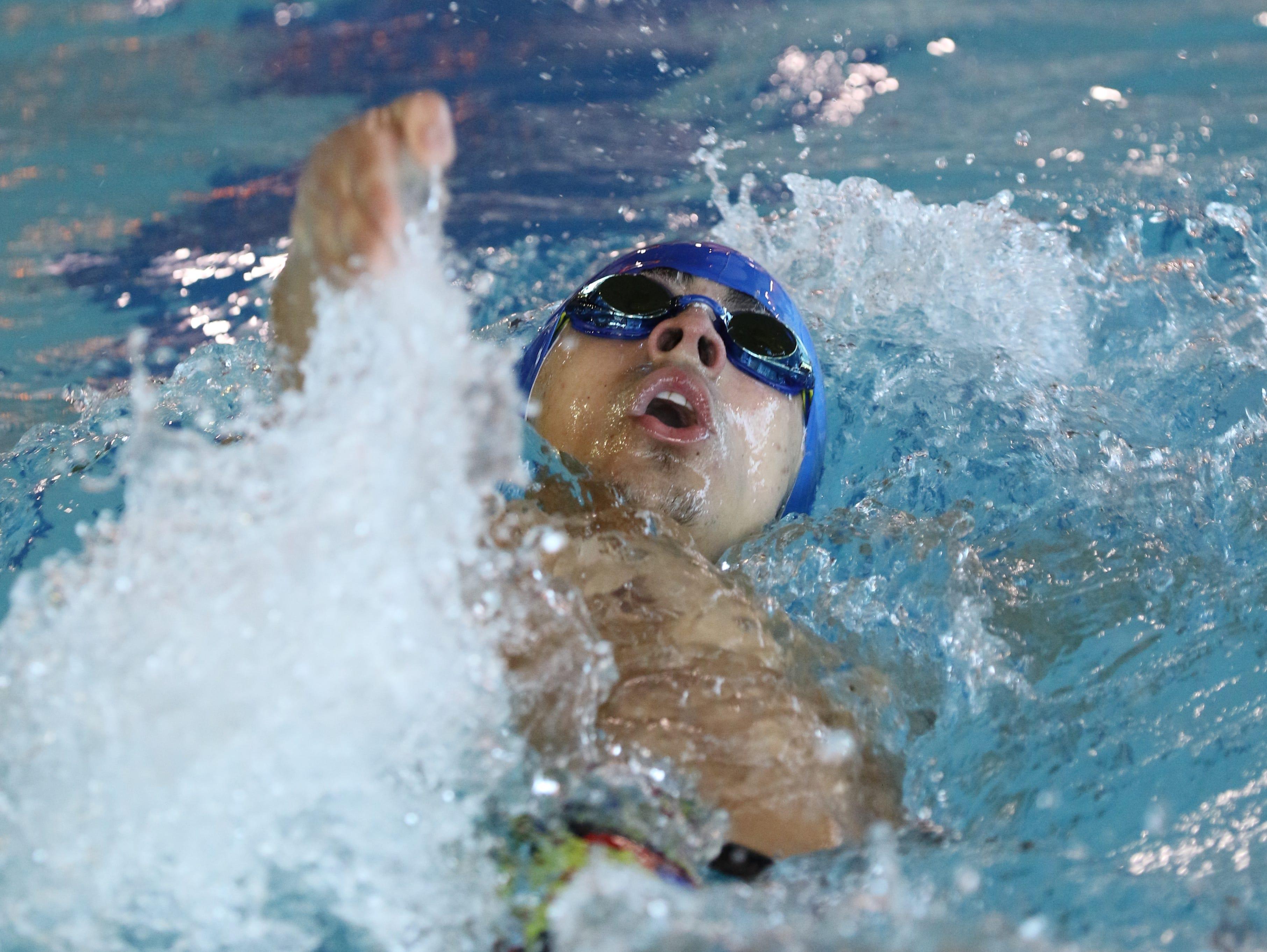 Justin Conillas of Passaic Tech wins the 100 Yard Backstroke.