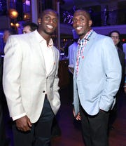 Jason McCourty, left, and Devin McCourty at a VIP reception hosted by the NFLPA in New Orleans in 2013.