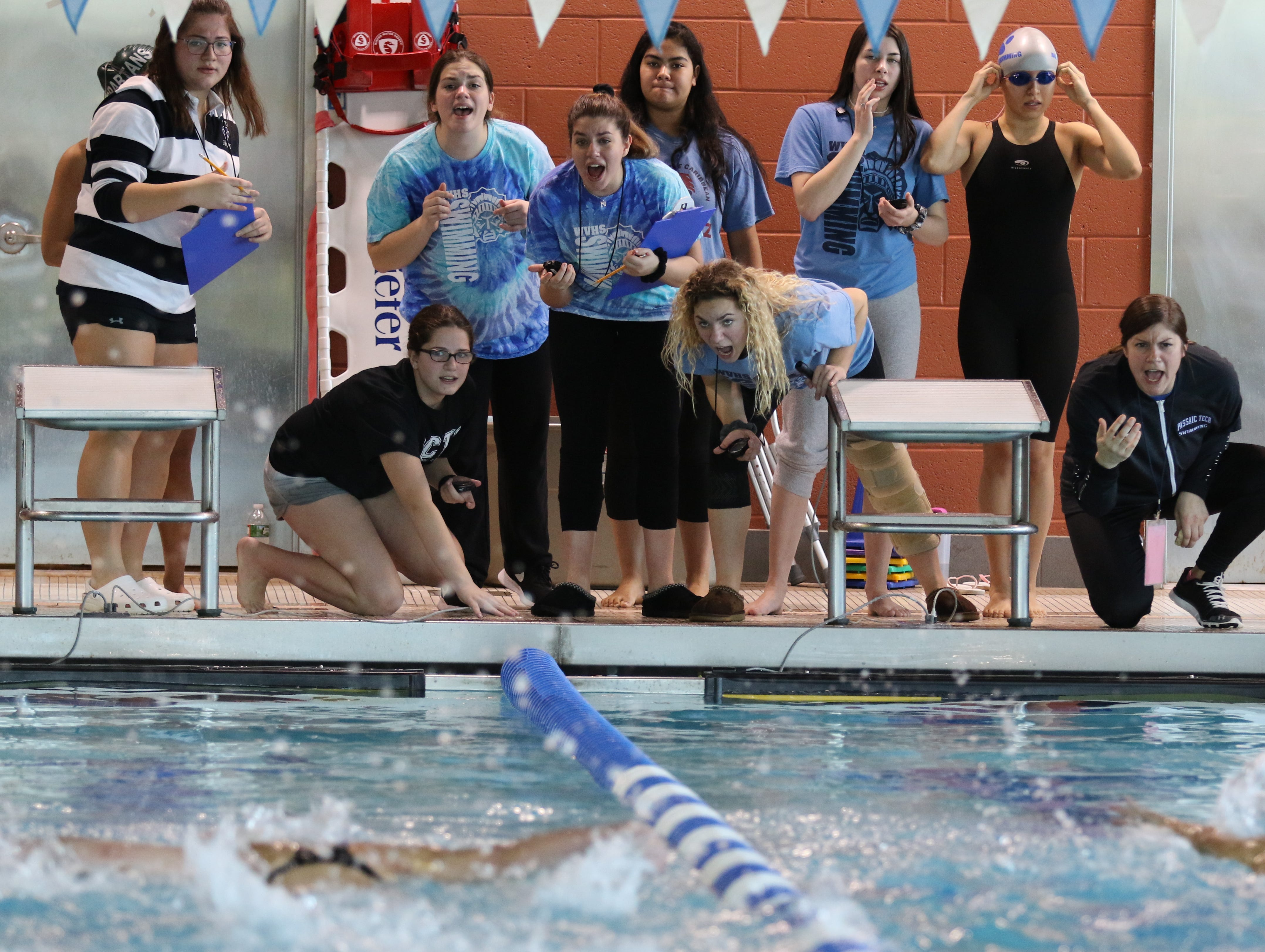 Wayne Valley cheers for their swimmer in the girls 200 Yard Butterfly.