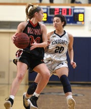 Northern Valley Old Tappan plays Westwood on Sunday, January 13, 2019 at IHA in Washington Twp. Meghan Riedel #20 looks to pass while under from Gianna Saccoccio #20.