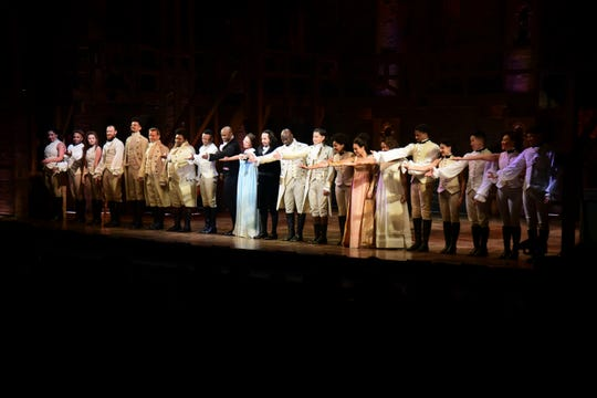 Actors of the the award-winning Broadway musical, Hamilton, including its composer and creator, New York native of Puerto Rican descent, Lin-Manuel Miranda, center, receive a standing ovation at the ending of its premiere held at the Santurce Fine Arts Center, in San Juan, Puerto Rico, Friday, Jan. 11, 2019.