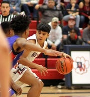 Sophomore Jordan Caballero looked for room to operate on the baseline against a tight Las Cruces High defense.