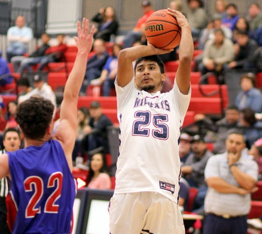Senior Wildcat Jose Trevizo (25) stepped up and challenged the Las Cruces High defense during Friday's 64-30 loss to the  visiting Bulldawgs.