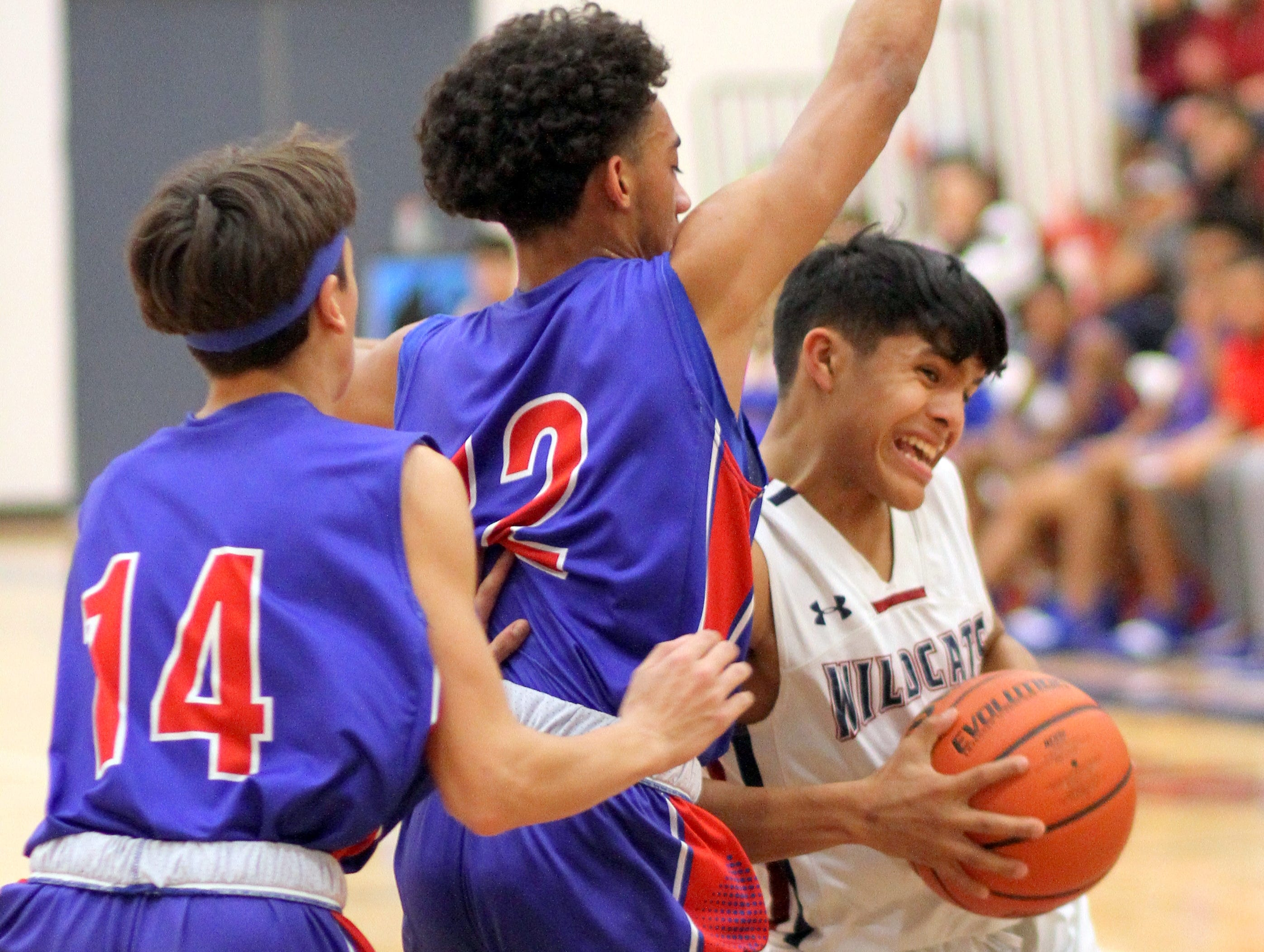 Wildcat guard Jordan Caballero bodied up to the Las Cruces High defense.