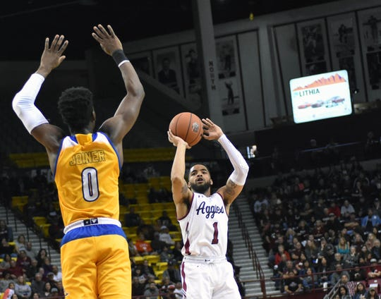 New Mexico State's Shunn Buchanan puts up a 3-point shot against Cal State-Bakersfield Saturday night at the Pan American Center
