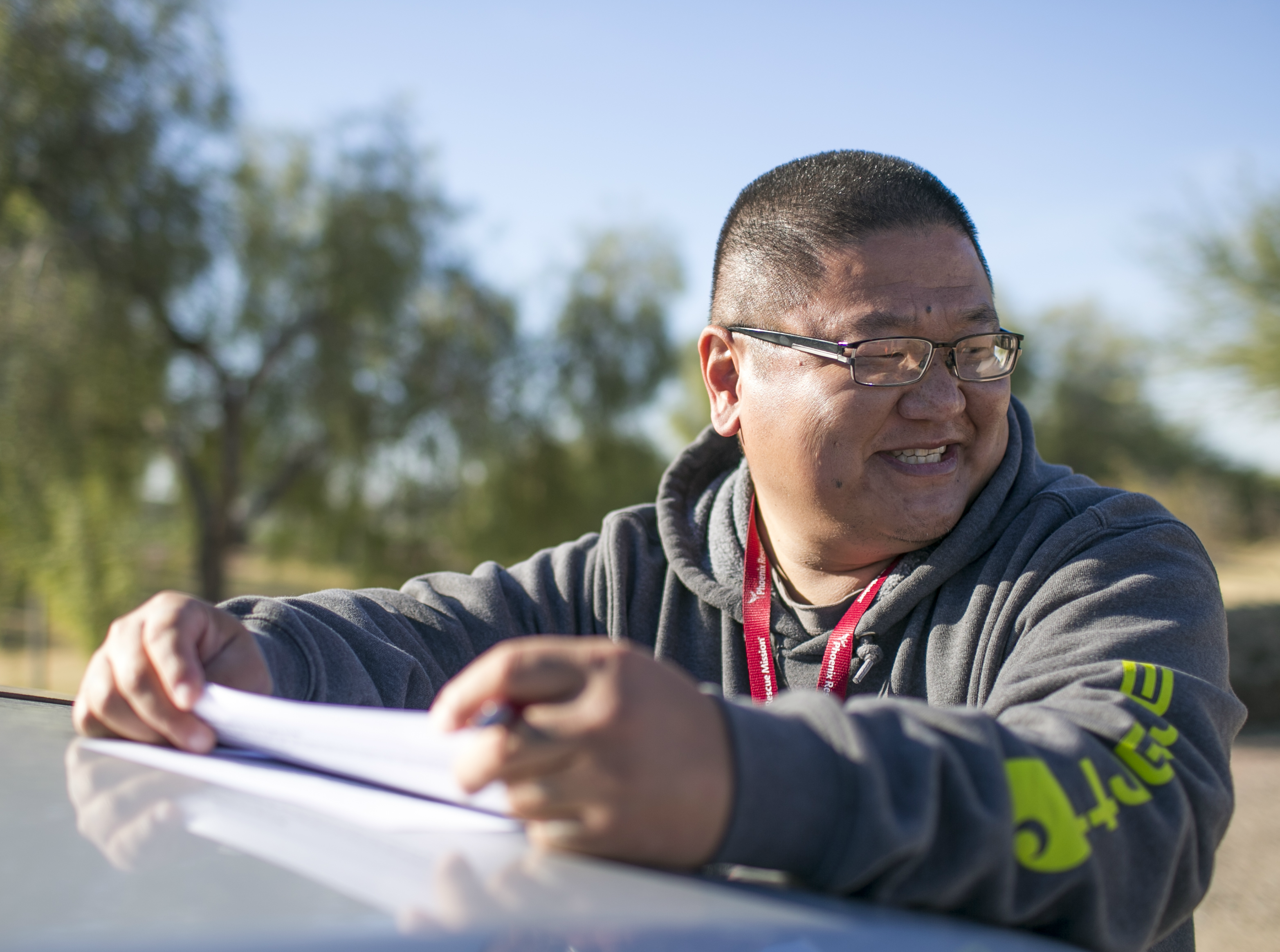 Gabe Priddy, a case manager assistant with Phoenix Rescue Mission, laughs while consulting with a client at the Glendale Works program on Jan. 7, 2019 in Glendale, Arizona.