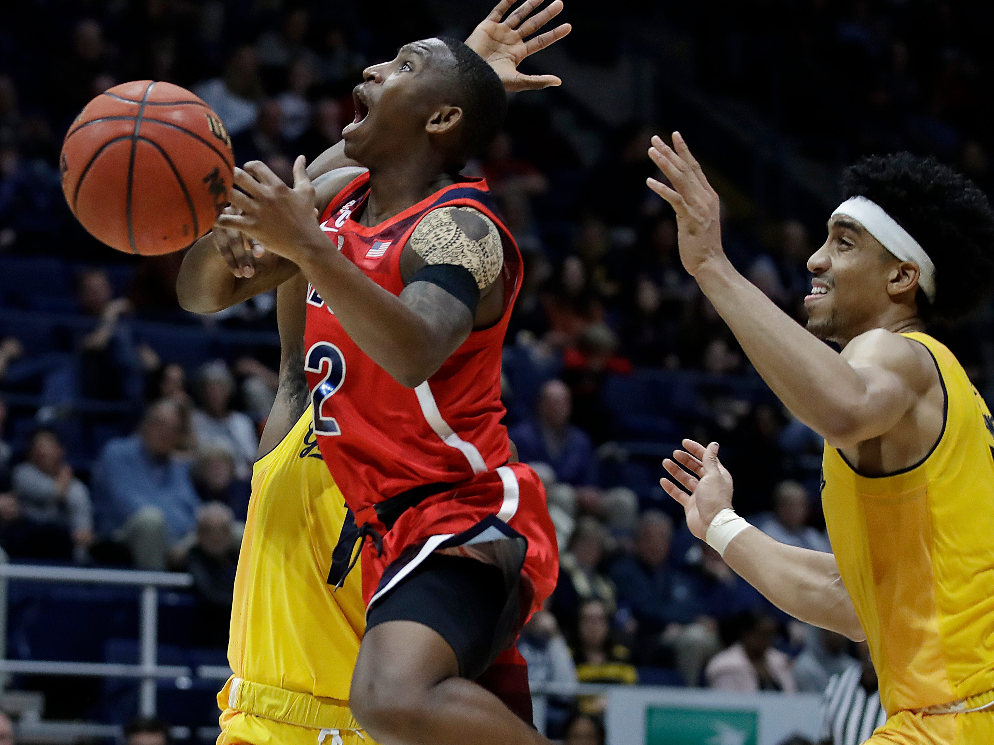 Arizona's Justin Coleman loses the ball as California's Darius McNeill, rear, defends during the second half of an NCAA college basketball game Saturday, Jan. 12, 2019, in Berkeley, Calif. (AP Photo/Ben Margot)