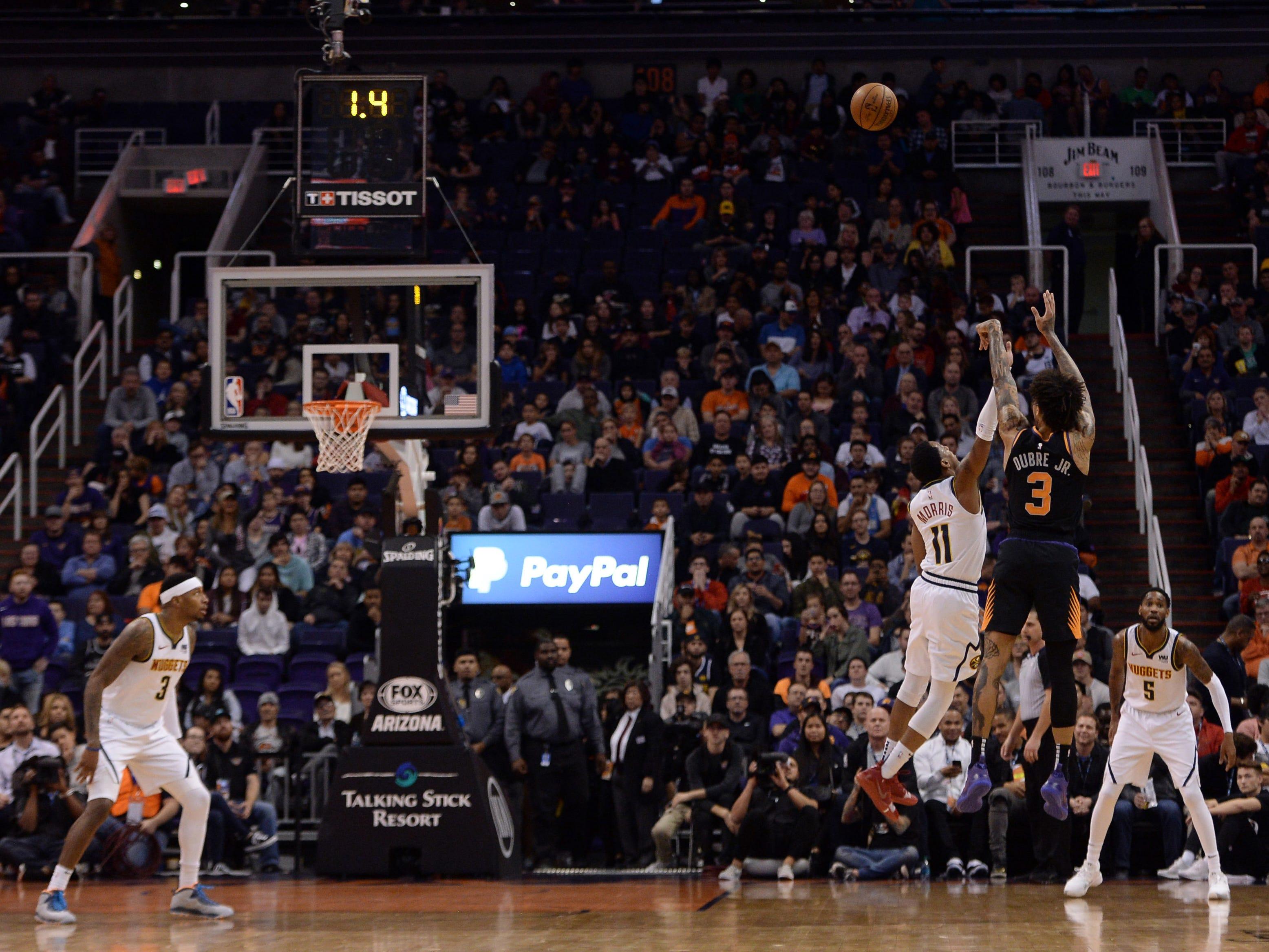Jan 12, 2019; Phoenix, AZ, USA; Phoenix Suns forward Kelly Oubre Jr. (3) shoots a buzzer beater three point shot against the Denver Nuggets during the second half. (Joe Camporeale-USA TODAY Sports)