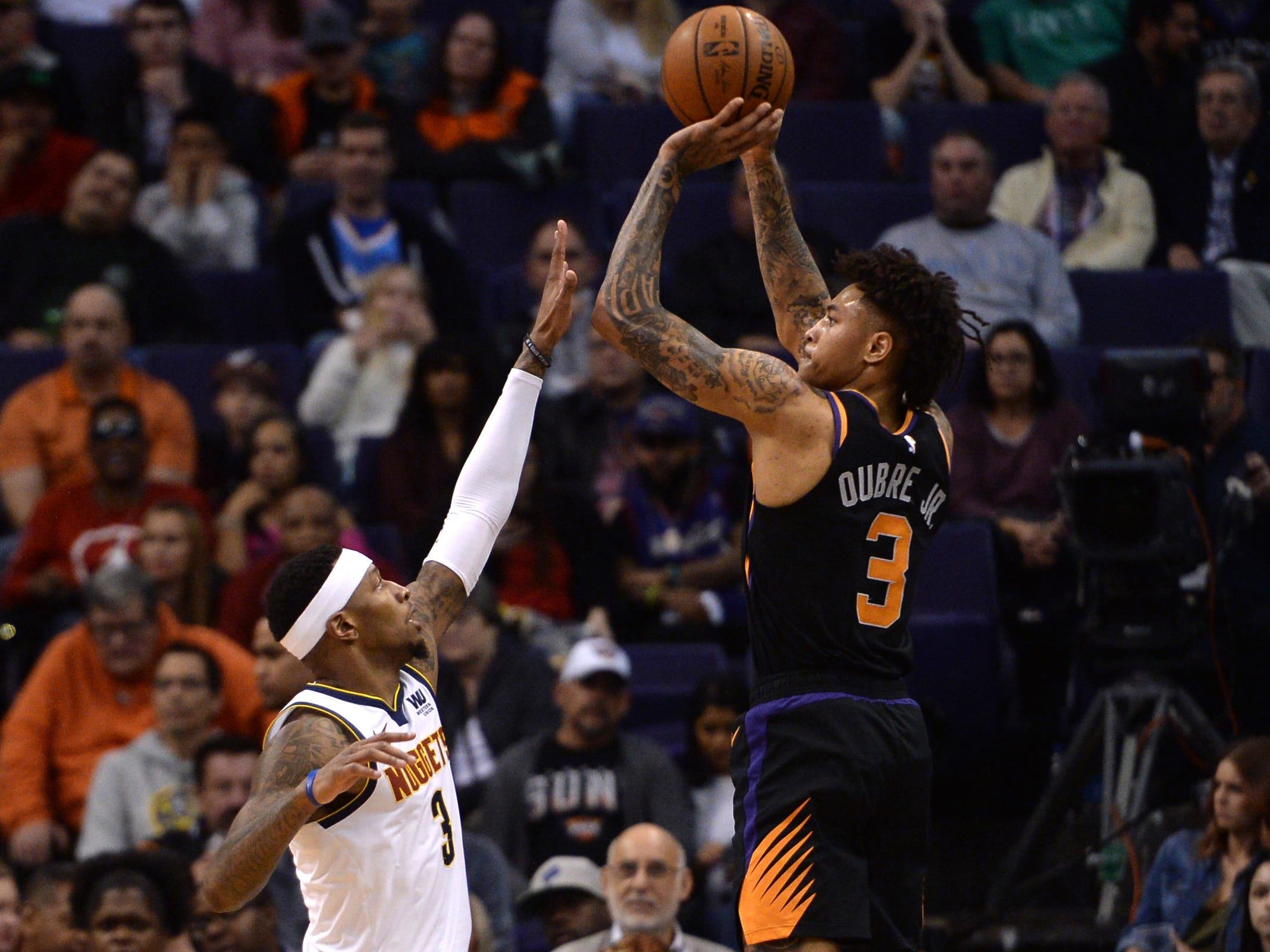 Jan 12, 2019; Phoenix, AZ, USA; Phoenix Suns forward Kelly Oubre Jr. (3) shoots over Denver Nuggets forward Torrey Craig (3). (Joe Camporeale-USA TODAY Sports)