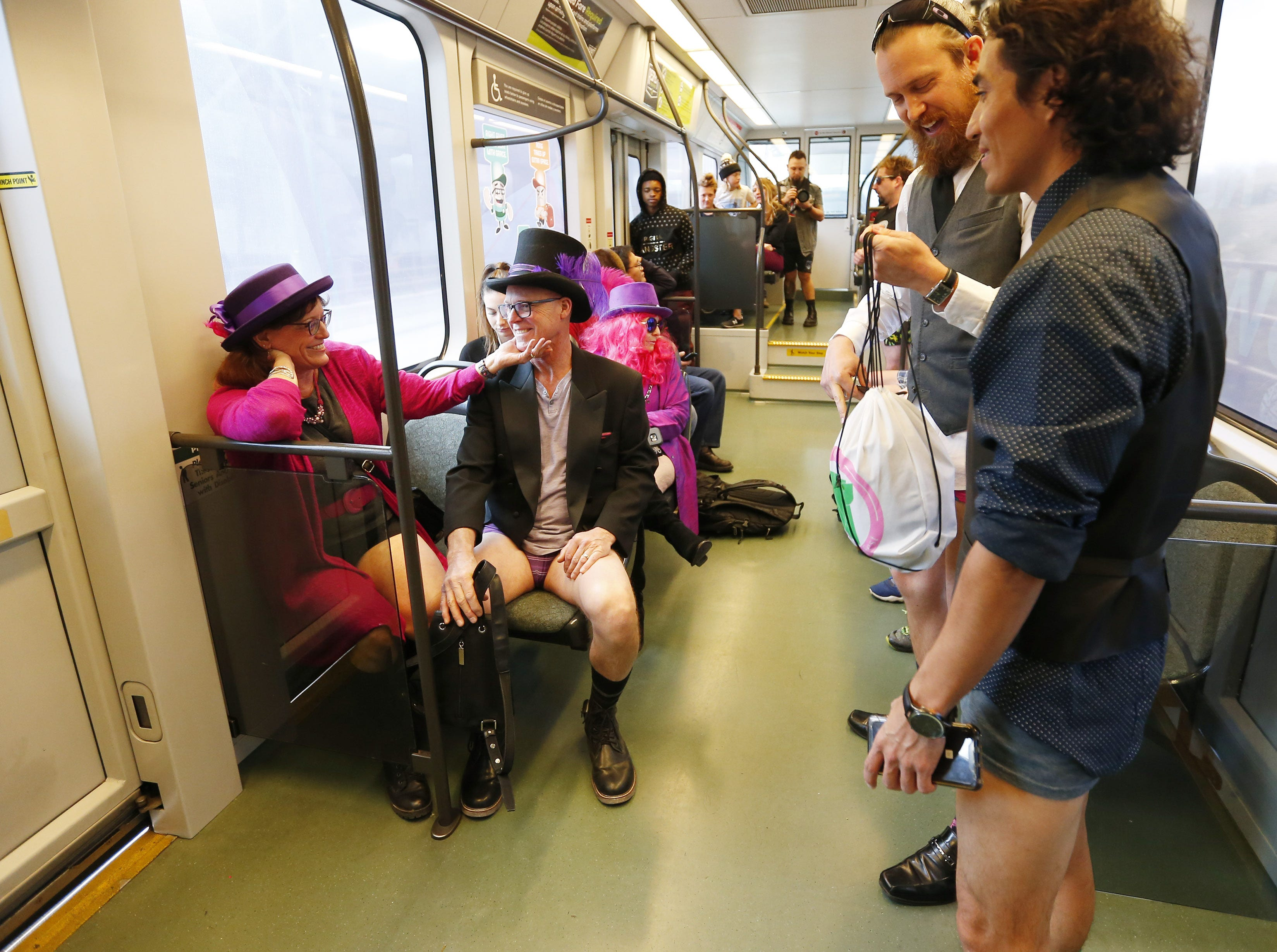 "Passengers ride the light rail during ""No Pants Light Rail Ride"" in Tempe, Arizona, on Jan. 13, 2019. People in dozens of cities all over the world rode public transportation without pants on the same day."