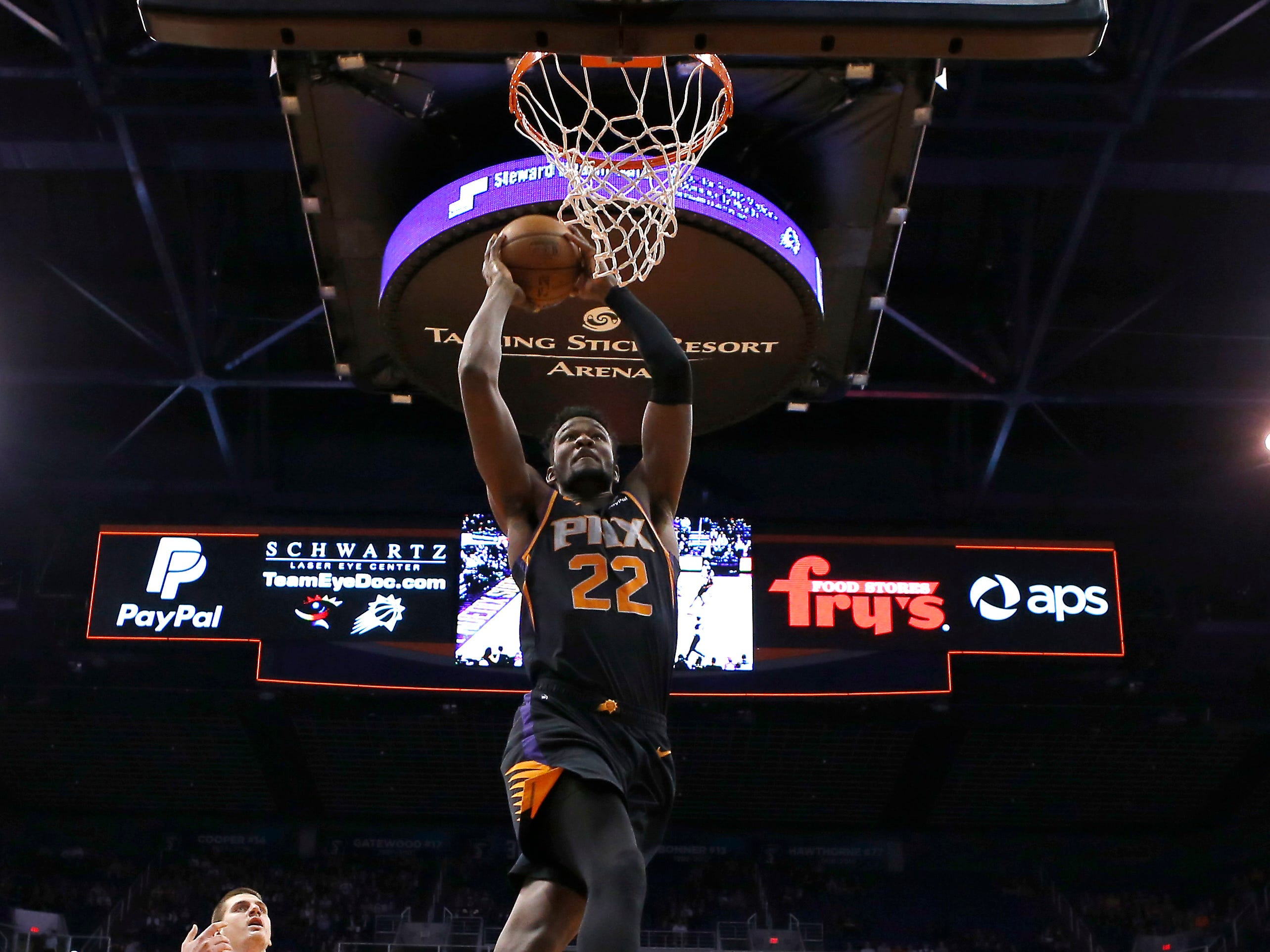 Phoenix Suns center Deandre Ayton (22) dunks against the Denver Nuggets in the second half, Saturday, Jan. 12, 2019, in Phoenix.  (AP Photo/Rick Scuteri)